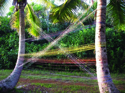 Wires and can taps create gentle hymn in the wind middle of the jungle. All the materials collected from the island´s junkyard*